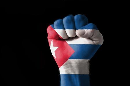 bandera cuba: Imagen de bajo perfil de un pu�o pintado en colores de la bandera de Cuba Foto de archivo