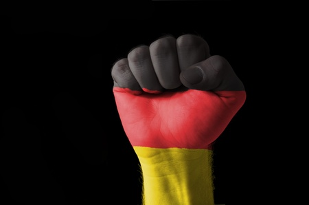 aggressor: Low key picture of a fist painted in colors of germany flag