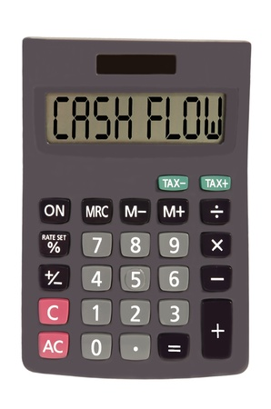 cash flow on display of an old calculator on white background