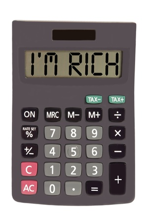 budgetary: im rich on display of an old calculator on white background