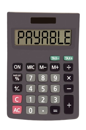 payable: payable on display of an old calculator on white background  Stock Photo