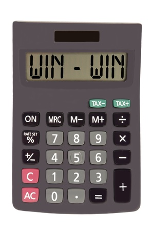 win - win on display of an old calculator on white background  photo