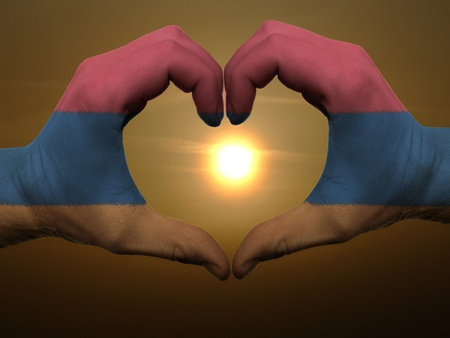 Gesture made by armenia flag colored hands showing symbol of heart and love during sunrise Stock Photo - 11112119