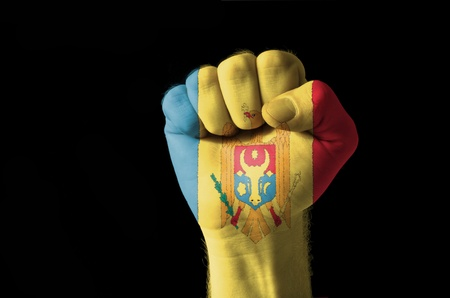 moldovan: Low key picture of a fist painted in colors of moldova flag