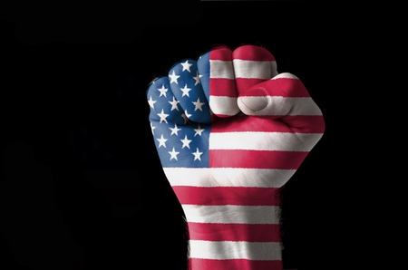 Low key picture of a fist painted in colors of american flag Stock Photo - 11112338