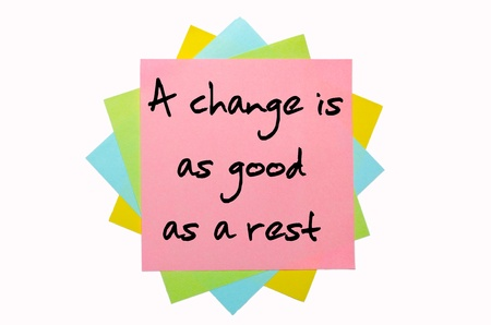 text 'A change is as good as a rest' written by hand font on bunch of colored sticky notes photo