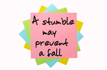 stumble: text A stumble may prevent a fall written by hand font on bunch of colored sticky notes Stock Photo