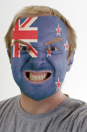 whose: High key portrait of an angry man whose face is painted in colors of new zealand flag Stock Photo