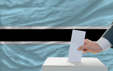 botswanan: man putting ballot in a box during elections in botswana Stock Photo