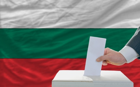 man putting ballot in a box during elections in bulgaria Stock Photo - 11284280