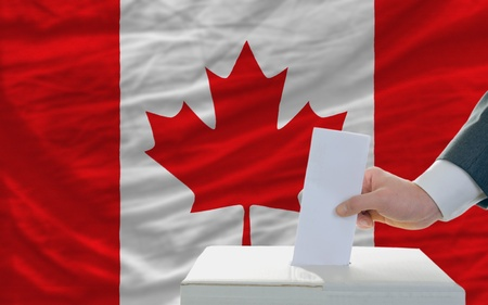 man putting ballot in a box during elections in canadal Stock Photo - 11284287