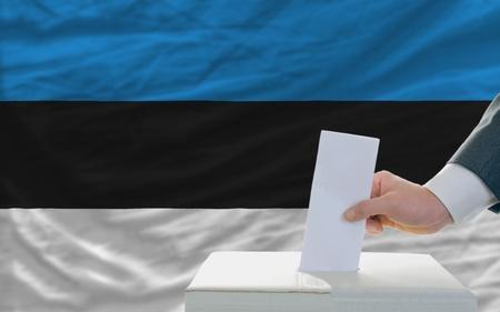 ballot box: man putting ballot in a box during elections in estonia Stock Photo
