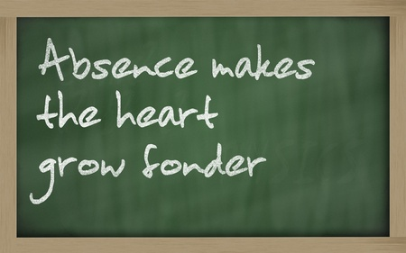 Blackboard writings Absence makes the heart grow fonder Stock Photo