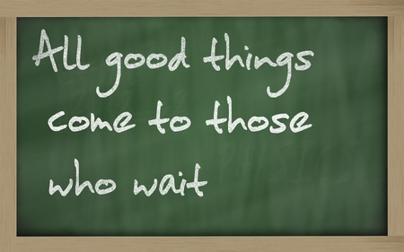 Blackboard writings 'All good things come to those who wait' photo