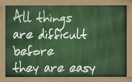 Blackboard writings 'All things are difficult before they are easy' photo