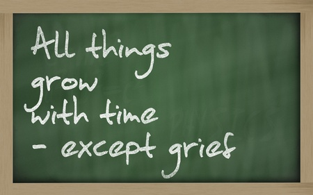 Blackboard writings 'All things grow with time - except grief ' photo