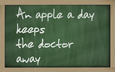 keeps: Blackboard writings An apple a day keeps the doctor away