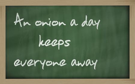 wriiting: Blackboard writings  An onion a day keeps everyone away