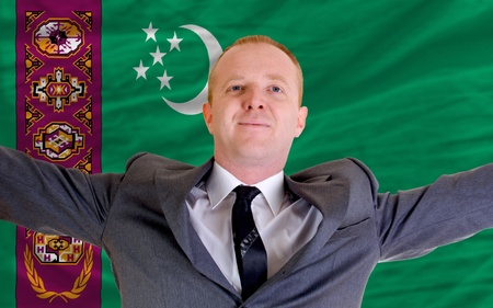spreading arms: joyful investor spreading arms after good business investment in turkey, in front of flag Stock Photo