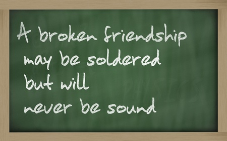 Blackboard writings A broken friendship may be soldered but will  never be sound  Stock Photo