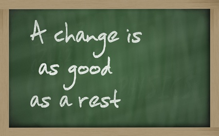 Blackboard writings 'A change is as good as a rest' photo