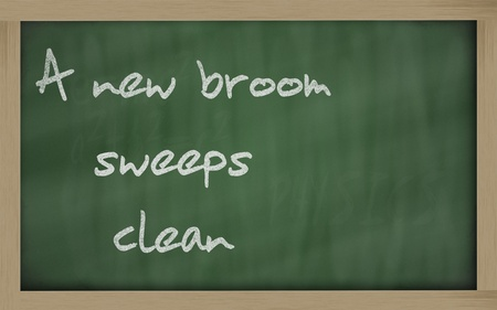 wriiting: Blackboard writings A new broom sweeps clean Stock Photo