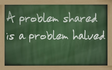 halved  half: Blackboard writings A problem shared is a problem halved  Stock Photo