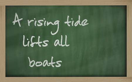 prudent: Blackboard writings A rising tide lifts all boats Stock Photo