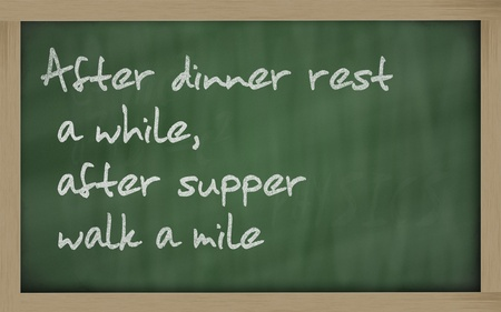 wriiting: Blackboard writings After dinner rest a while, after supper walk a mile Stock Photo