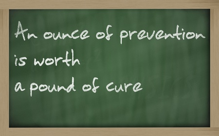 ounce: Blackboard writings An ounce of prevention is worth a pound of cure Stock Photo