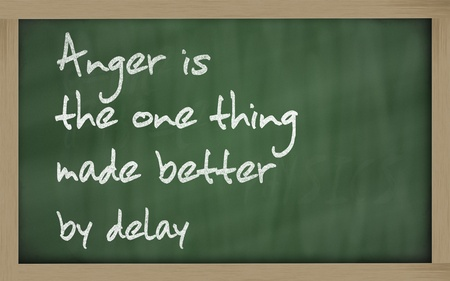 wriiting: Blackboard writings Anger is the one thing made better by delay Stock Photo