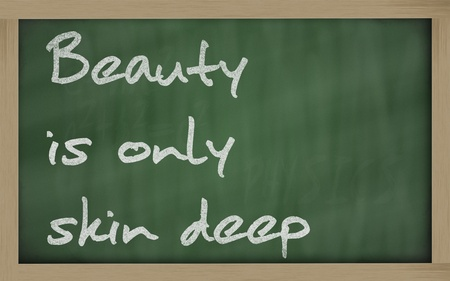 inner beauty: Blackboard writings  Beauty is only skin deep  Stock Photo
