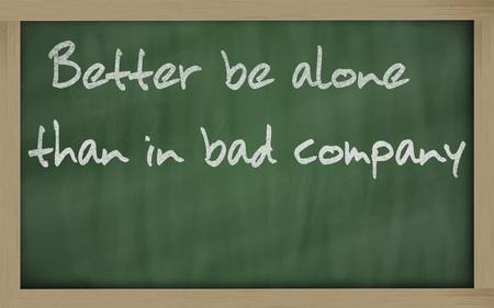 Blackboard writings Better be alone than in bad company  Stock Photo