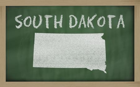 drawing of south dakota state on chalkboard, drawn by chalk
