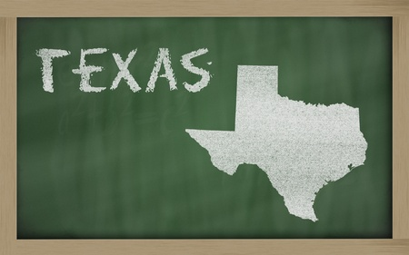drawing of texas state on chalkboard, drawn by chalk photo