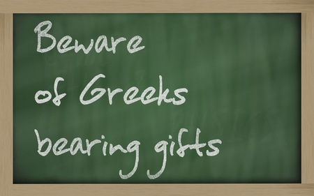 beware: Blackboard writings Beware of Greeks bearing gifts Stock Photo
