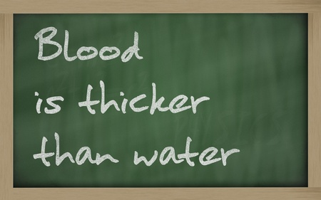 wriiting: Blackboard writings Blood is thicker than water Stock Photo