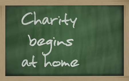 Blackboard writings Charity begins at home photo