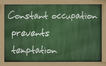 constant: Blackboard writings Constant occupation prevents temptation  Stock Photo