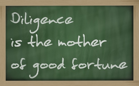 wriiting: Blackboard writings Diligence is the mother of good fortune  Stock Photo