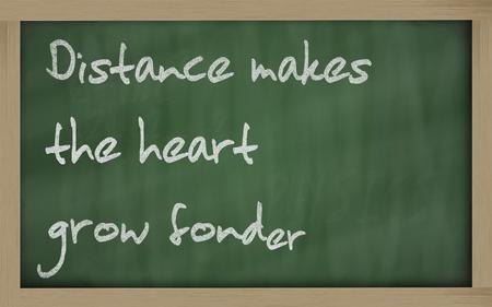 wriiting: Blackboard writings  Distance makes the heart grow fonder  Stock Photo