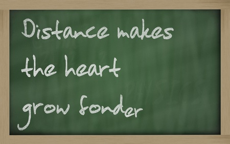 Blackboard writings  Distance makes the heart grow fonder  Stock Photo