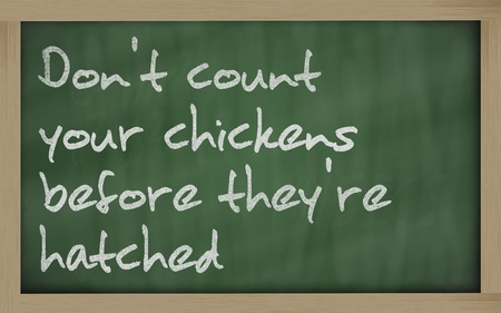 Blackboard writings Dont count your chickens before theyre hatched