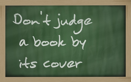 cover: Blackboard writings Dont judge a book by its cover Stock Photo
