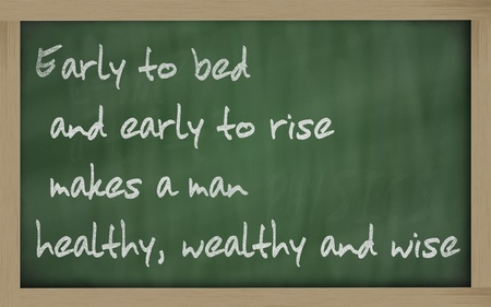Blackboard writings Early to bed and early to rise makes a man  healthy, wealthy and wise