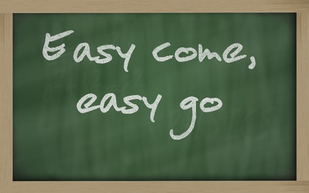 Blackboard writings Easy come, easy go Stock Photo