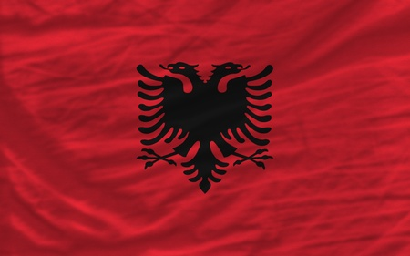 complete national flag of albania covers whole frame, waved, crunched and very natural looking. It is perfect for background photo