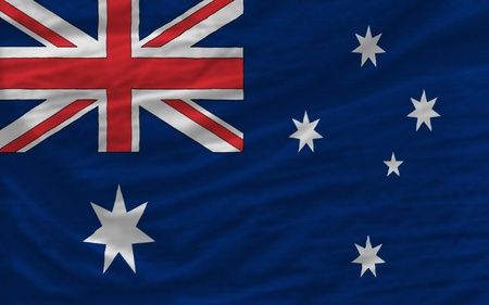australia: complete national flag of australia covers whole frame, waved, crunched and very natural looking. It is perfect for background Stock Photo