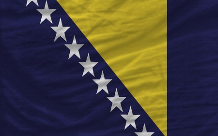 bosnia and  herzegovina: complete national flag of bosnia herzegovina covers whole frame, waved, crunched and very natural looking. It is perfect for background