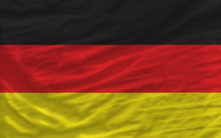 piktogramm: complete national flag of germany covers whole frame, waved, crunched and very natural looking. It is perfect for background Stock Photo